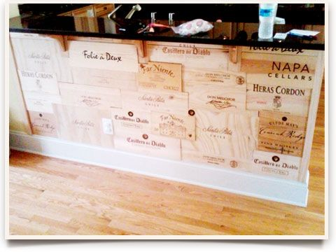 What an excellent idea!!! Using old wine crates as a scuff-preventer on a kitchen island!!!! (used natural stain and polyurethane to protect)