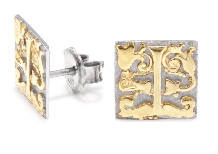 Sterling silver earrings with raised gold plate detail. £445