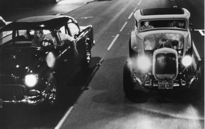 Bob Falfa (Harrison Ford; '55 Chevy) and John Milner (Paul Le Mat; '32 Ford) confront each other for the first time in American Graffiti
