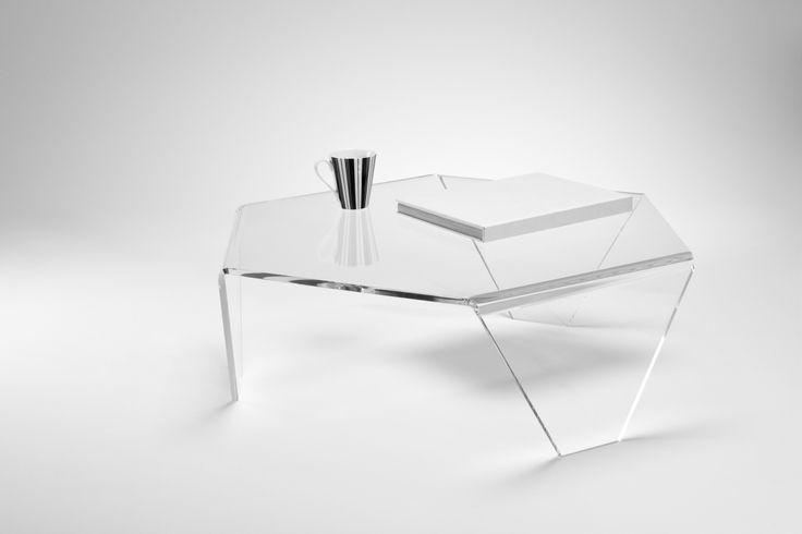 An ultra modern hexagonal acrylic table will enhance the look of any space.