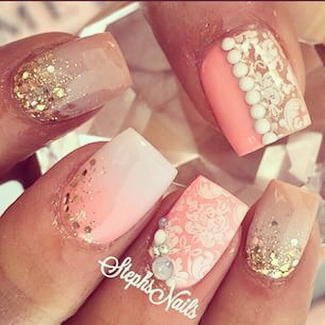 We <3 this! pretty and pink. Gorgeous mixes of lace and glitter make this mani stand out.