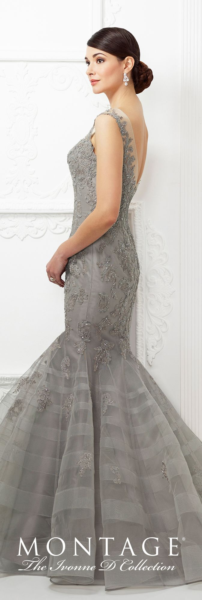 brand logo 217D81  Sleeveless lace and tulle trumpet gown with illusion trimmed front and back V-necklines, dropped waistline, tulle skirt features horsehair stripes and scattered lace appliqués, sweep train. Matching shawl included.