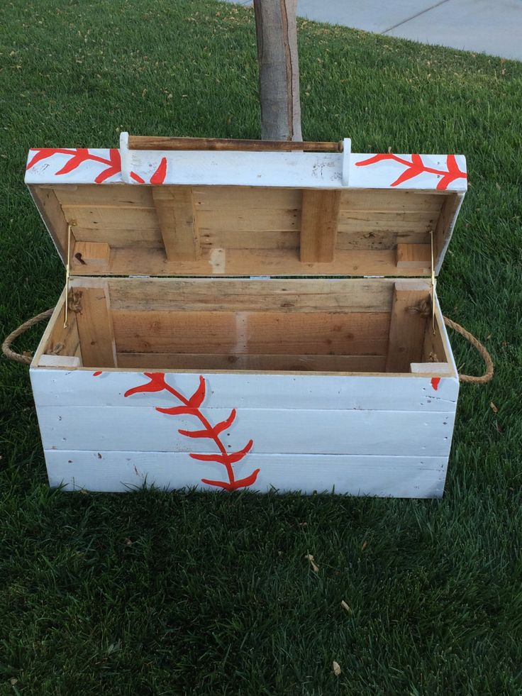 "This MADE TO ORDER custom Baseball Toy Box, is a perfect addition to any nursery, bedroom or playroom! The hand built, hand painted, Baseball themed toy box is made of reclaimed pallet wood. The dimensions of the toy box are (H) 18"" (L) 38"" (W) 18"". The weight of the toy box is 50 lbs. Please be sure to measure prior to purchasing to ensure it will be a perfect fit for your needs! The toy box comes with 2 looped rope handles on either side of the box making it easier to move. The lid of the…"
