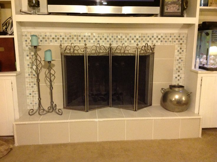 Mosaic tile fireplace fire place redo over red brick - Tiling a brick fireplace ...