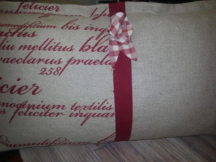 Cushion In Il Scripto col:red done by Inca Interiors