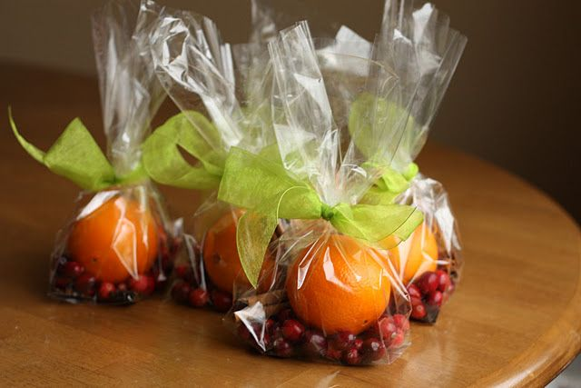 """Stove-top potpourri kits. Cute neighbor gift idea: one orange, 1/2 c cranberries, 1 Tbs whole cloves, 3 sticks cinnamon, a bit of grated nutmeg.  Instructions: """"Quarter the orange, place all in a small saucepan filled with water and simmer on lowest setting. Refill water as needed."""""""