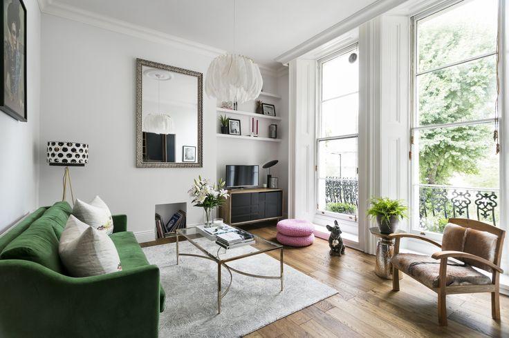 """""""My husband and I bought this one bedroom apartment in leafy West London from our local authority. It was in a very sorry state and hadn't been updated for many years but the magnificent Georgian sash windows and beautiful high ceilings won me over immediately and I knew I had to have it."""""""