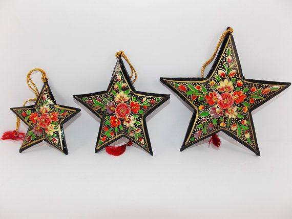 Holiday ornaments of Papier Mache Stars by GoDoozy.  Papier mache is a delicate decorative art which shows the artistic zeal of a craftsman. This art was introduced in Kashmir in the 15th Century by a Prince who spent years in prison at Samarkand in Central Asia. The ingenious artisans of Kashmir transform a variety of utility articles into beautiful works of art. The process of making paper mache items, which is passed down by generation to generation as a part of Kashmiri culture.