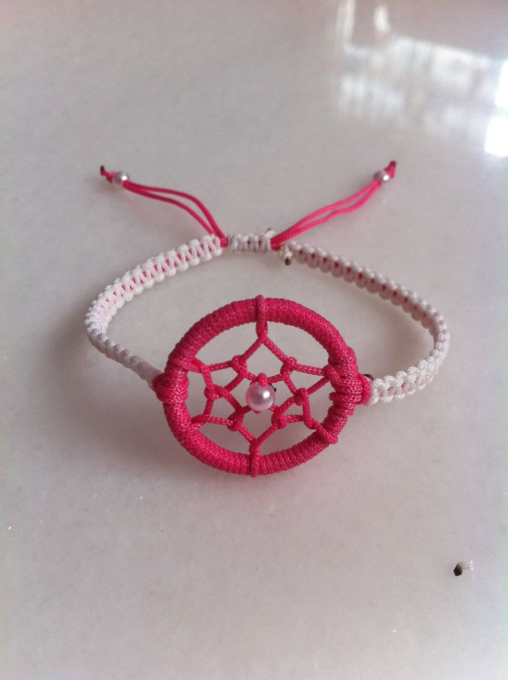 light pink and dark red dream catcher bracelet. Instead of chain, it twisted thing strings to hang on wrist.