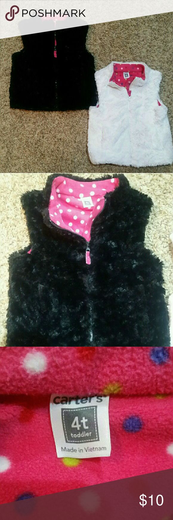 2 for $10. 2- soft and fuzzy reversible vests 1 black and 1 white with bright pink polka dot interior ... like new condition Children's Place Jackets & Coats Vests