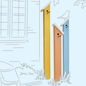 Love these birdhouses - from Lowe's Spring idea book. Though I would choose more natural colors