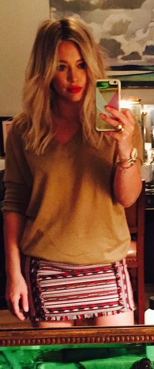 Who made  Hillary Duff's tan v neck sweater and print skirt?