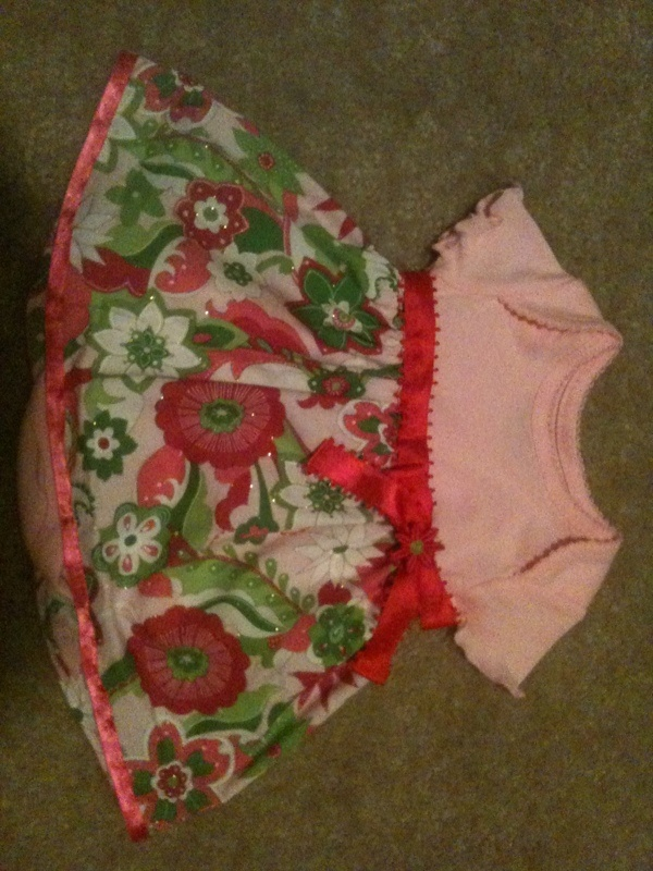 Infant onsie dress embellished with ribbon and decorative flower