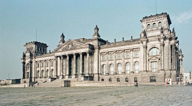https://flic.kr/p/pGDVVV | Reichstag - Berlin - 1977 | The Reichstag, home of the Germany Parliament in earlier times and again now, is almost deserted, since the capital of West Germany moved to Bonn while the Berlin Wall was in place, and didn't move back to Berlin until reunification of West Germany with the German Democratic Republic (DDR). The dome was subsequently added (see my photos flic.kr/p/funzFx and flic.kr/p/ohaTS). Now there are always lines to get into the building. ☺