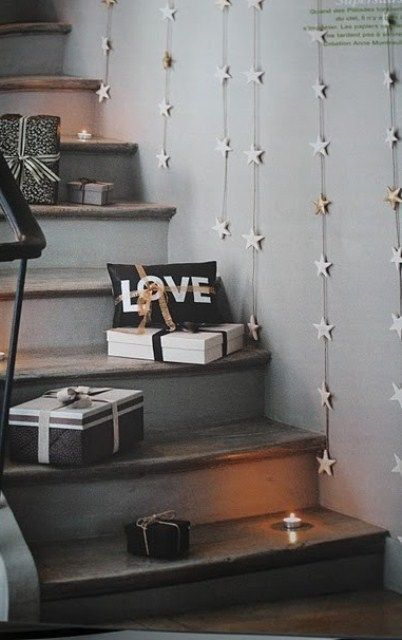 Paper Stars Threaded with Twine - easy DIY decor, and you can keep them up for a New Years Party. Cute :)