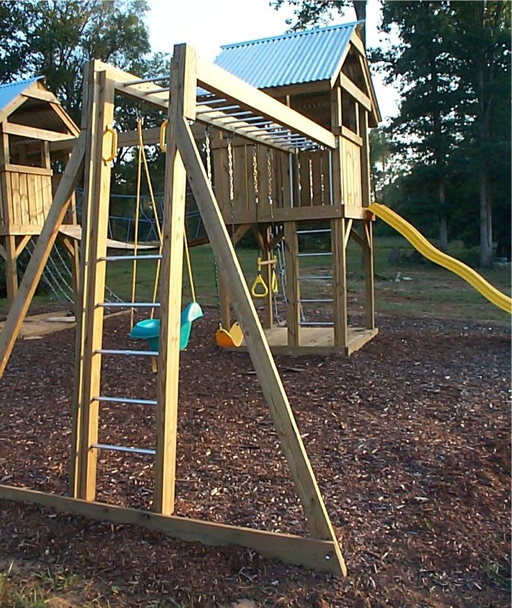 A custom playground with towers monkey bar swings slide for Playground blueprints
