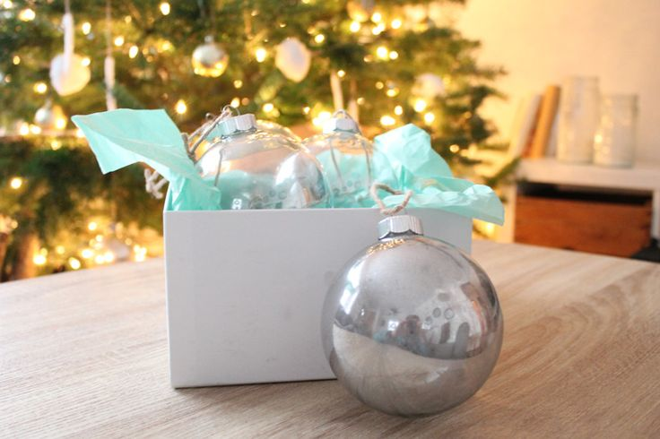 A simple tutorial for DIY mercury glass ornaments that will look beautiful hanging on your tree!
