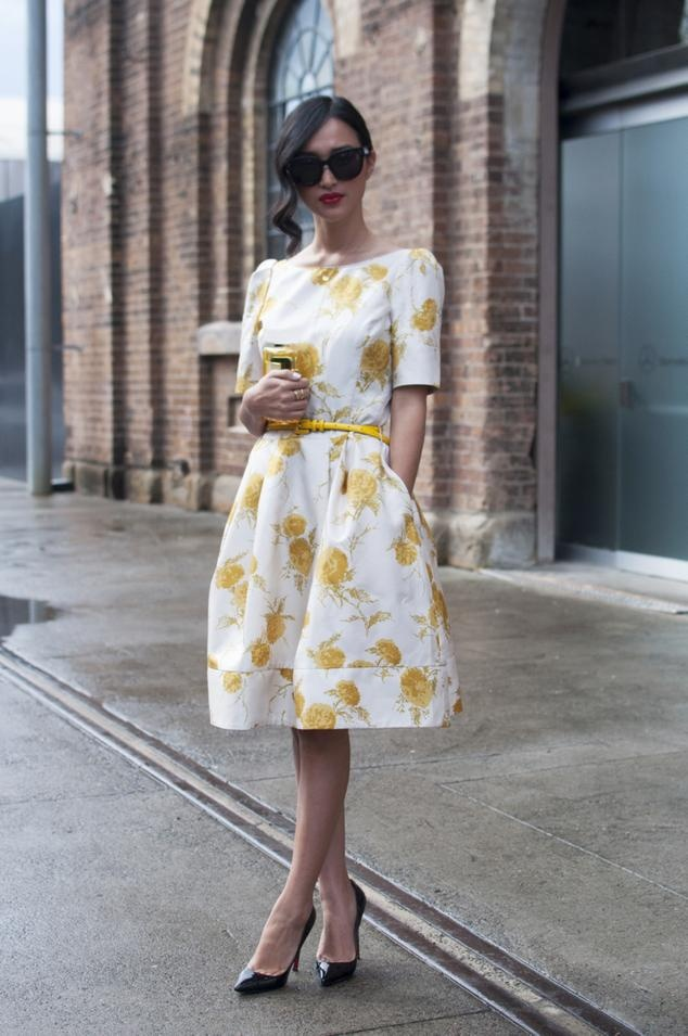 Delicate yellow floral, midi dress with elbow length sleeves, bold shoulder