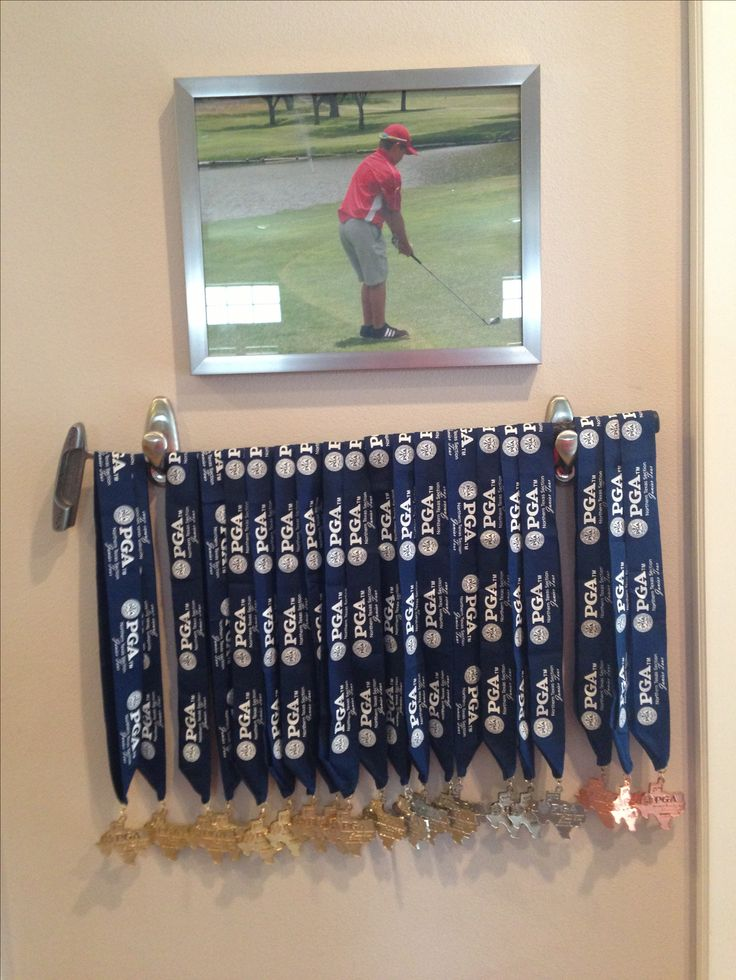 i used davis first putter to hang his medals from this summers golf tournaments and