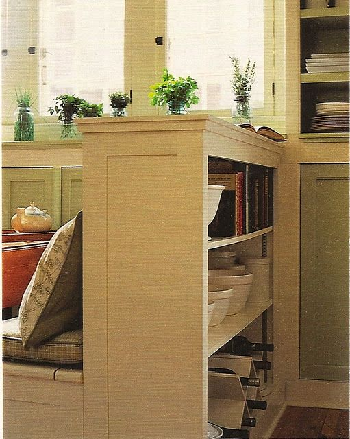 bookcase behind banquette in kitchen   Great storage solution for all my cookbooks, clean eating & bon appetit cooking magazines nestled in their ikea magazine holders.