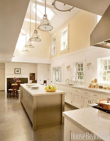I dream about an eat-in kitchen like this with a fireplace, ceiling windows and xtra long marble island.....mmmmm