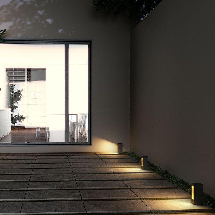 TREEZA LED 25 | rendl light studio | Outdoor bollard with a golden lacquered inside that creates a soft warm light. #lamp #garden #bollard #black