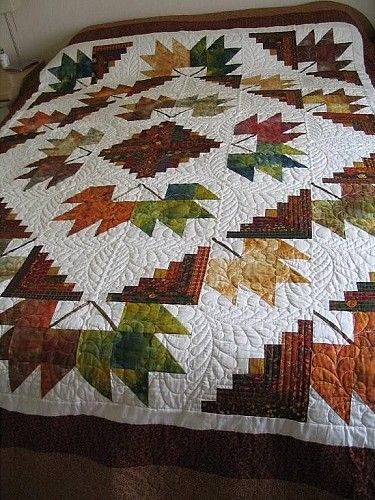 Leaves Around the Cabins.  I would like to try this quilt but make it with Deb Tucker's leaf instead. With the Corner Beam unit it is a beautiful leaf.
