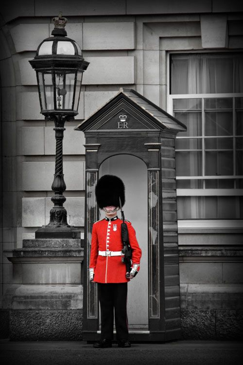 Buckingham Palace guard... a lil scared to kiss one with the giant gun buuuuut id ask, maybe could kiss a button on the coat ?
