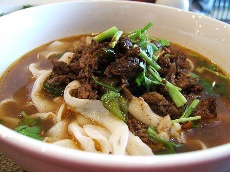 spicy cumin lamb biangbiang noodles in lamb bone broth