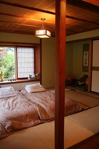 Japan- the perfect family bedroom with futon on tatami floor.