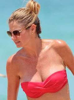 View the gallery / 56 pictures. . . . . . Wearing a strapless red and black bikini, Erin Andrews looked in great spirits as she splashed around in the Miami sea with her ESPN collague, Charissa Thompson on 06/12/12. The former Dancing With The Stars contestant wore her brunette blonde hair piled on top of her head and displayed her flawless complexion with minimal make up.