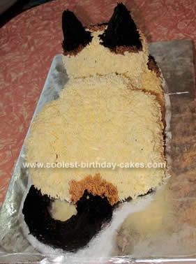 My daughter wanted a Siamese Cat Birthday Cake for her 6th birthday. I made three chocolate cakes (23cm round, 23cm square and a 12cm square) ahead of