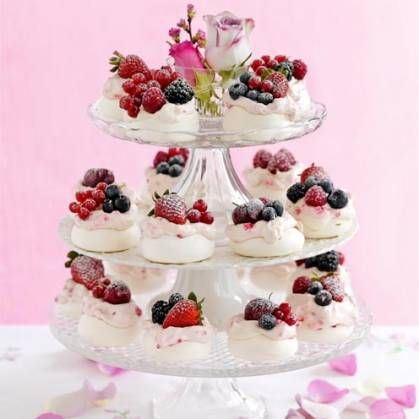 Mini meringues with white chocolate, raspberry whipped cream, and berries (Good Housekeeping). Nice presentation.