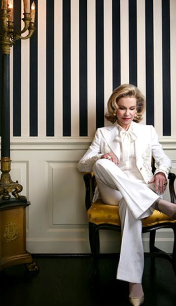 Both the white suit AND the striped walls.