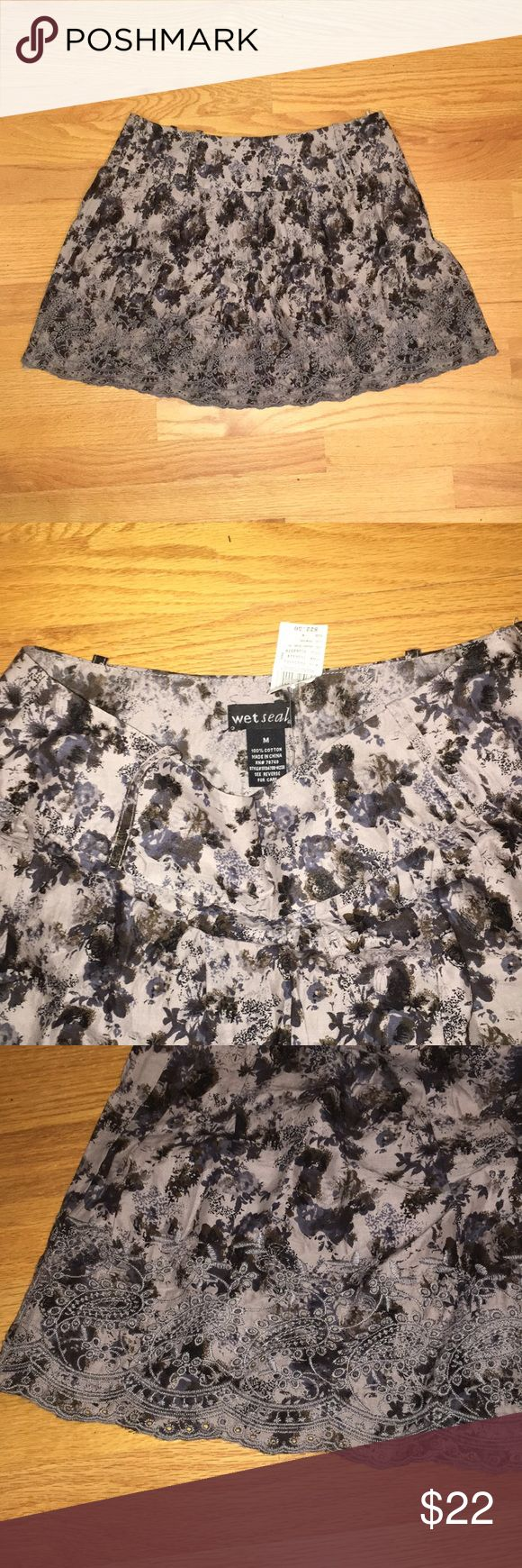 NWT wet seal floral mini skirt NWT wet seal floral mini skirt with embroidered lace pattern along hem Wet Seal Skirts Mini