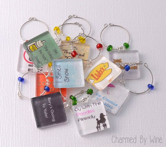 Gilmore Girls Theme Wine Charms (Choice of 2,4,6,8 or 10 charms)  *** IF ORDERING LESS THAN 10 CHARMS, PLEASE INDICATE YOUR CHOICE OF CHARMS IN THE NOTE TO SELLER BOX IN YOUR SHOPPING CART! ***  This is THE wine charm set for any fan of Gilmore Girls! These glass tile charms are handcrafted to represent many of the shows most popular and favorite moments. Charms included in the full set are:  1. Lukes Diner 2. The Dragonfly Inn 3. No Cell Phones sign (from Lukes Diner) 4. 1000 Yellow Daisys…