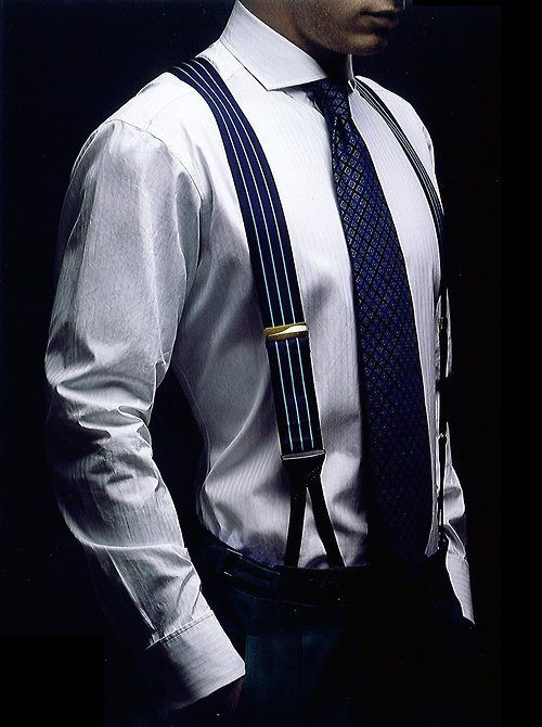 Blue patterned tie and vertical striped navy blue suspenders, with a hint of gold trim-  make this quite the dapper suit