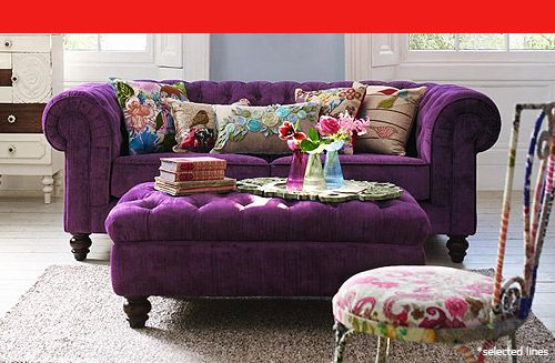 Purple Chesterfield Sofa and pretty, colourful cushions.