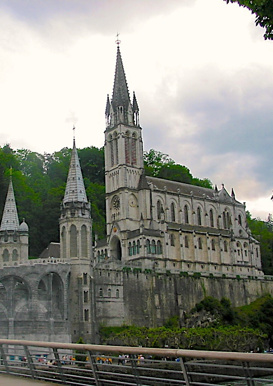 Basillica at Lourdes, France - It is built on a rock known as Massabielle. On the west is the front of the Rosary Basilica while on the east is the Crowned Statue. The Basilica is actually three separate churches built at different periodsAlong River Gave, there are taps where water flows out from the miraculous spring. People queued to collect the water. Only when you are at the Basilica, then you will understand the wonders of that place