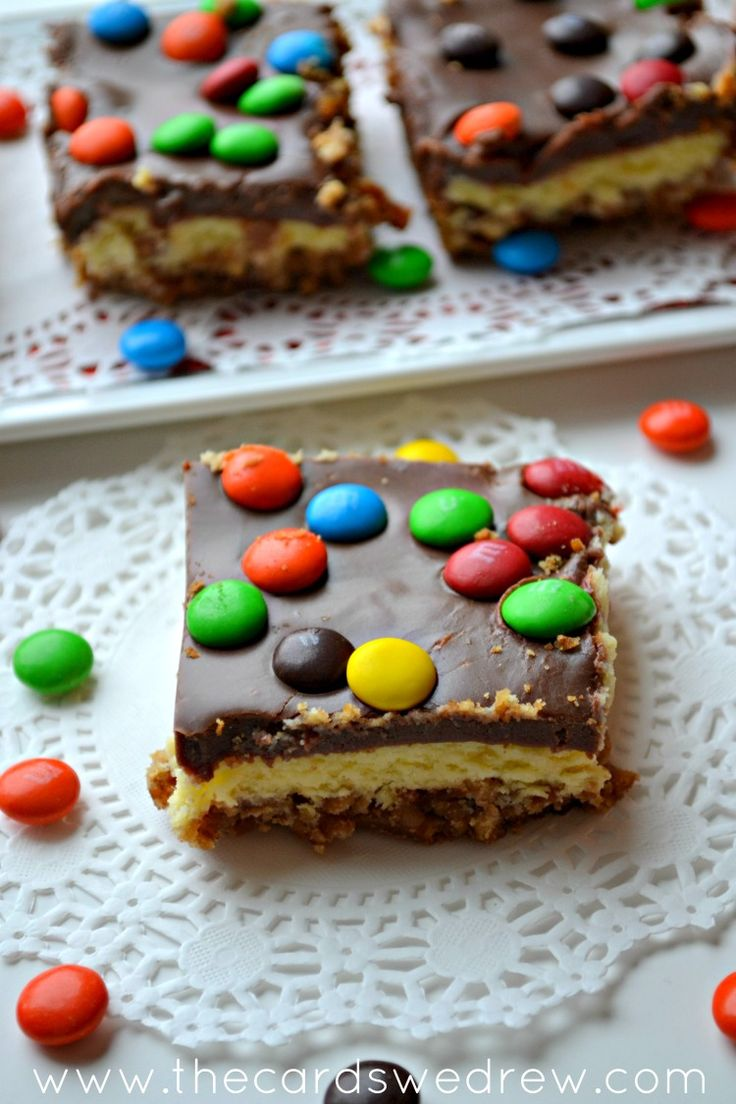 M&M Cheesecake Bar with Pretzel Crust and Chocolate Icing from The Cards We Drew