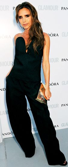 Victoria Beckham looks ever so chic and sleek in a black strapless jumpsuit on the red carpet at the Glamour Women of the Year Awards in London on June 4, where she was crowned Woman of the Decade at the awards ceremony.