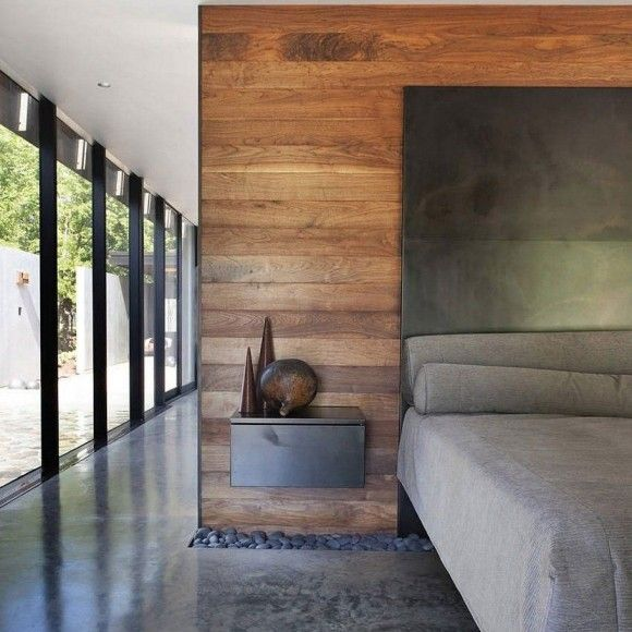I like the finely-tailored feeling of these materials used together in this space -- rolled steel, concrete, wood, glass.