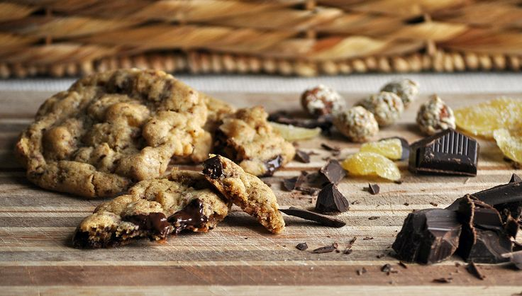 Chunks of milk and dark chocolate mingle with candied ginger and sesame honey almonds in a buttery brown sugar dough.