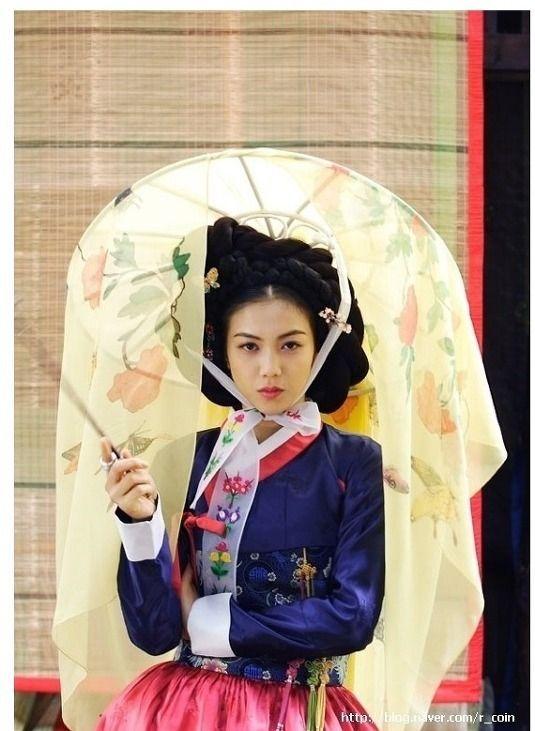 Hanbok with fancy traditional head wear.