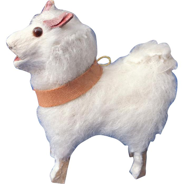 Up for sale is a very nice miniature white toy Spitz dog. I think he is covered with mohair and has the old putz toy wooden legs and tiny glass eyes.