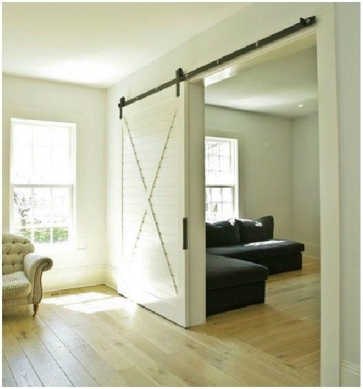 45 best images about barn doors on pinterest window for Sliding barn door living room