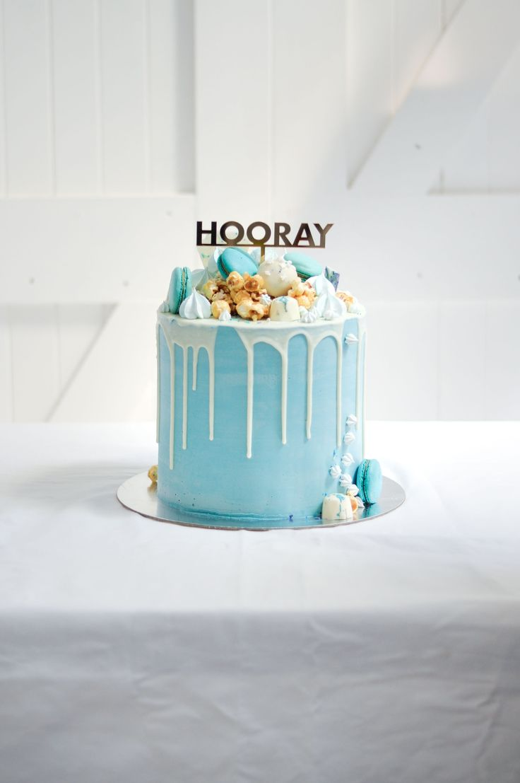 Blue and White over the top candy baby shower cake by LionHeart
