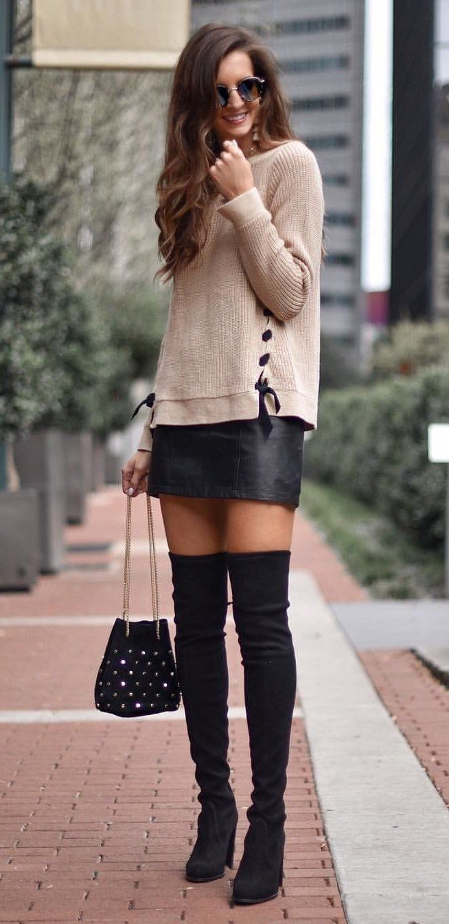 #fall #outfits  women's knitted beige sweatshirt, black leather mini skirt, pair of black thigh-high boots, and black handbag outfit