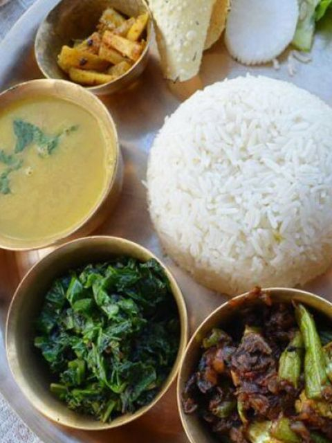 Dal Bhat (lentil stew and rice served with vegetables and chutneys), the staple dish of Nepal. Absolutely delicious, never the same twice.