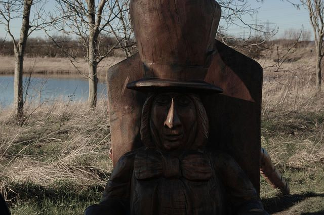 Mad hatter wooden statue woodlands
